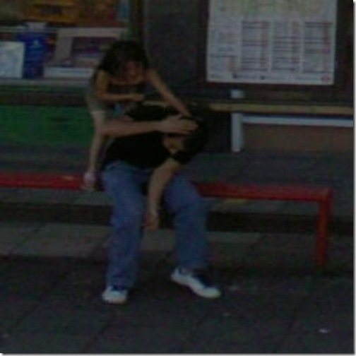 Little sister beating up her bigger brother at a bus stop