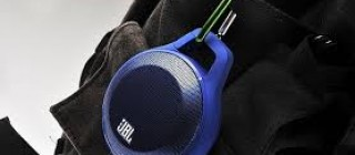 JBL Clip bluetooth speaker clipped onto a backpack
